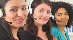Three customer service representatives smiling Stock Footage