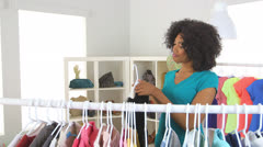 African American woman trying on clothes in store Stock Footage