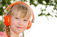 Stock Photo of closeup portrait of cheerful girl listening lesson