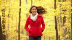 Autumn woman happy running in fall forest - stock footage