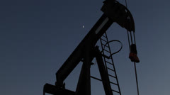 Oil Well Rig with Moon Stock Footage