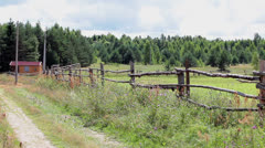 Wooden fence along rural road in Russian village Stock Footage