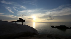 Man Performing Hatha Yoga By The Sea Stock Footage