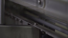 Plastic Moving Through a Machine In a Factory HD Video Stock Footage