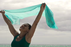 Woman with pareo standing on the beach, slow motion shot at 240fps Stock Footage