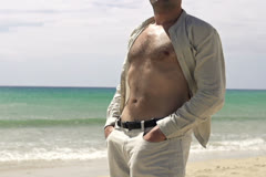 Man relaxing on the beach, slow motion shot at 240fps Stock Footage
