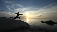Yoga: Man Performing Warrior Pose By The Sea Stock Footage