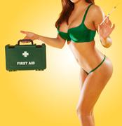 sexy woman carrying a first aid kit - stock photo