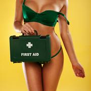Stock Photo of sexy busty woman with a first aid kit