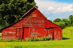 Old red rustic barn - stock photo