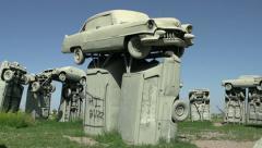 Cars forming Carhendge tilt shot Stock Footage