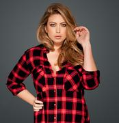 Stock Photo of gorgeous blond in a red checked shirt