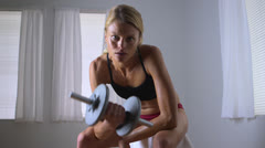 Fit woman lifting weights Stock Footage