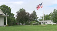 American Flag in yard of American Gothic House Stock Footage