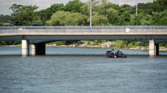 Power boat under bridge Stock Footage