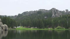 Lake Sylvan with mountains in background Stock Footage