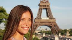 Tourist at Eiffel Tower, Paris smiling happy Stock Footage