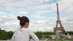 Paris Eiffel Tower woman looking and waving Stock Footage