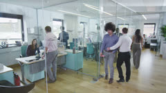 Multi ethnic young professionals working together in contemporary office Stock Footage
