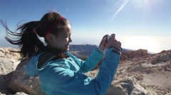 Hiker woman photographing taking pictures on Teide - stock footage