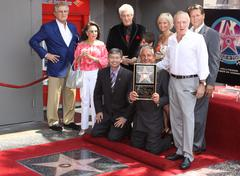 Stock Photo of george hamilton induced with star on the hollywood walk of fame