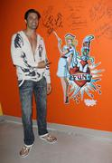 Stock Photo of gilles marini visits the ed hardy outlet store