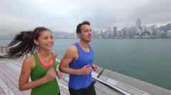 Runners - running couple jogging in Hong Kong city Stock Footage