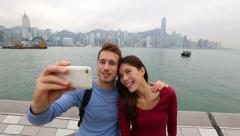 Tourists couple taking picture in Hong Kong Stock Footage