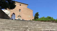 Nuns walking down steps in Rome (dolly) Stock Footage