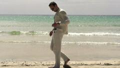 Man walking on the beach, slow motion shot at 240fps Stock Footage