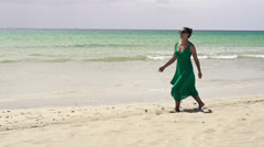Woman walking on the beach, slow motion shot at 240fps Stock Footage