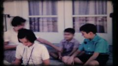144 kids gather on front porch of house - vintage film home movie Stock Footage