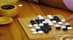 Chinese Japanese Korean strategy Go game board for beginner - stock footage