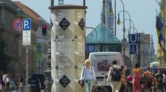 Munich urban downtown pedestrian cyclist traffic passing Germany Stock Footage