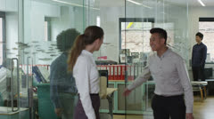 Portrait of happy young business people in a contemporary office Stock Footage