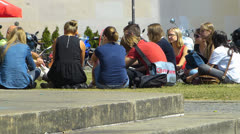 Students sitting gathering in Campus Munich LMU university Germany Stock Footage