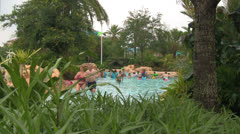 People at Orlando Water Park Surrounded by Lush Garden Stock Footage