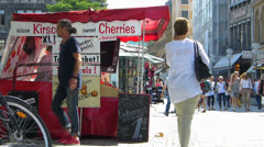 Munich downtown Cherries sale Stall pedestrian shopper consumer commuter busy Stock Footage