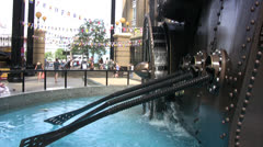 Mechanical machine with water wheel and paddles in central London Stock Footage