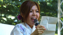 Japanese singer Chance sing Country Road in Japan Festival Munich Stock Footage