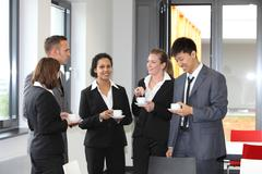Group of diverse businesspeople on coffee break Stock Photos