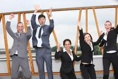 successful business team cheering and rejoicing - stock photo