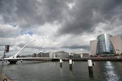 black clouds and bridge dublin irland - stock photo