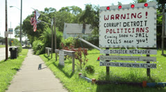 Stock Video Footage of Warning Corrupt Detroit Politicians Sign at park