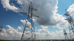 Panorama with tall electric masts against cloudy sky Stock Footage