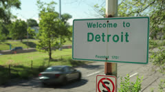 Up Close Street Sign Welcoming to Detroit On Pole Next To Street Stock Footage