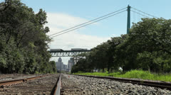 Detroit and Ambassador Bridge from train tracks Stock Footage