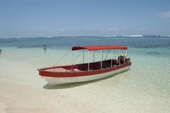 Boat on white sand bocas del toro panama Stock Photos