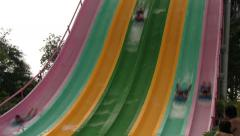 Water Park Guests Racing Down Colorful Speed Slides (with Sound) Stock Footage
