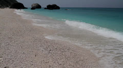 Ripples lave a shingle beach at the coast of Ionian sea Stock Footage